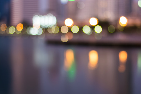 Abstract, night cityscape light blur bokeh, defocused background, Thailand. photo