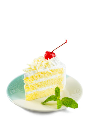 cake topping: white cake delicious, vanilla cake topping with white chocolate chips decorated with whipped cream and cherries white mint on dish on white background.