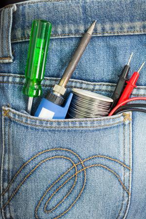Pocket jean and tool gun solder