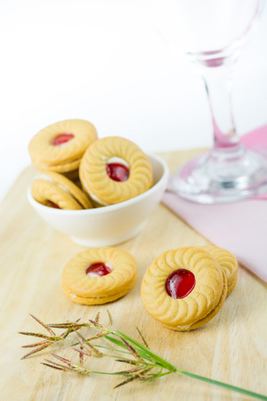 strawberry jam sandwich: Sandwich cookies with cream and strawberry flavoured jam on white background.
