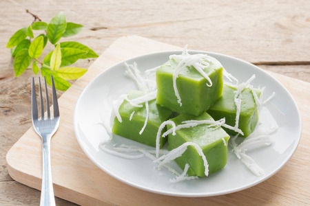 Green coconut sweet pudding Delicious decorated with white coconut meat on wood background or
