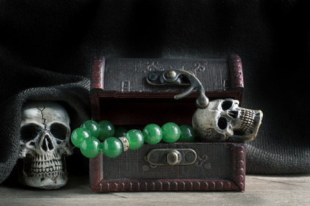 gruesome: Treasure chest old with Jewelry and human skull. Still life.