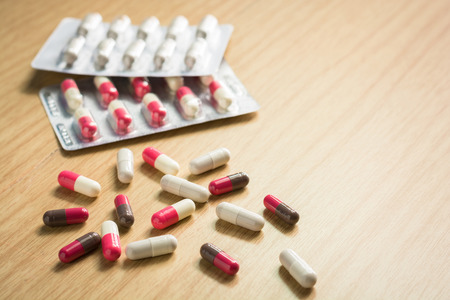 antibiotic pink pill: Drug capsules white and pink with panels drug. healthcare and medicine medication cure. Stock Photo