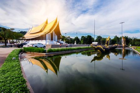 Tourist visitors to the merit Wat Dhammayan with Naga statue in Phetchabun Thailand.