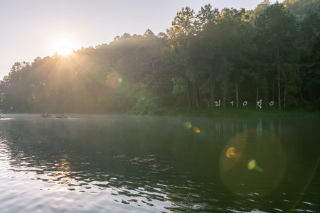 Pang Ung lake(translate from text in image), Muang Mae Hong Son Thailand is beautiful place and really nice atmosphere. Sunrise with lens flare and pine trees river fog cold in winter. Standard-Bild