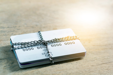 Credit card account is blocked the chain lock. It is not possible to make transactions. Data theft protection credit card security concept.