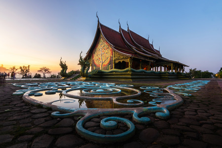 Sirindhorn Wararam Phu Prao Temple (Wat Phu Prao) Ubon Ratchathani Thailand or popularly called Glowing temple reflection of water during twilight sunset.