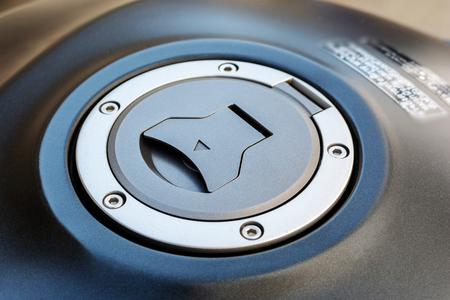 Closeup of black motorcycle fuel tank cover.
