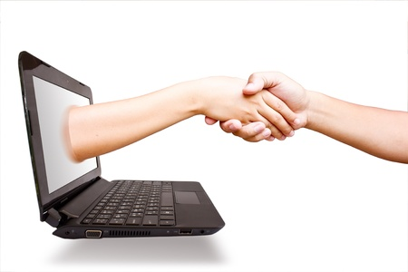 shake hands: Hand laptop. Stock Photo
