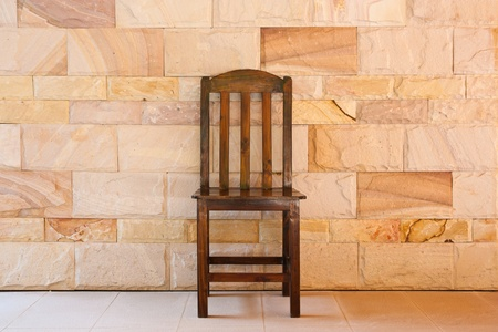 Chair, a rock wall. photo