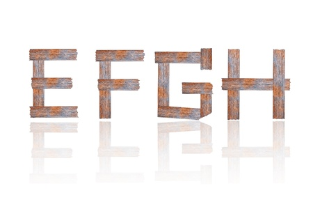 typesetter: Alphabet - letters from wooden boards. Isolated over white