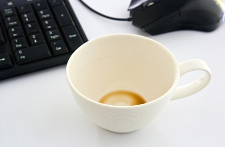 Cup of coffee and computers. photo