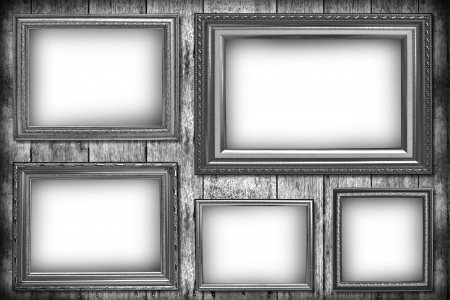Wooden photo frame on old wooden wall in black and white. photo