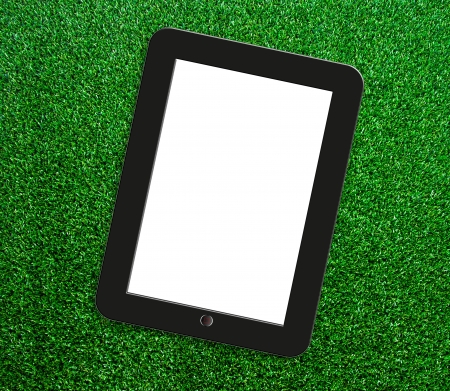Tablet on the grass. photo