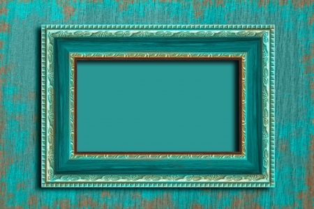baroque room: Frame on a vintage blue wall.