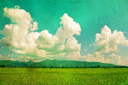 Feld und Himmel, Jahrgang Hintergrund Standard-Bild