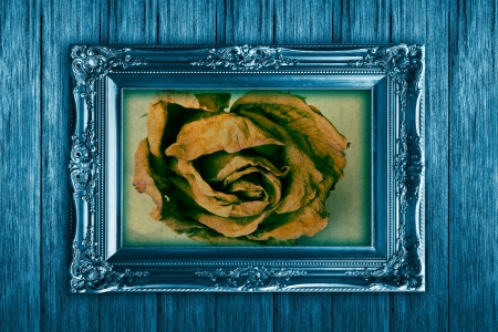Frame on vintage wooden wall blue. photo