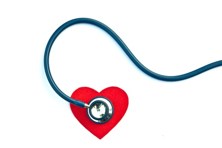 Stethoscope and heart on a white background. photo