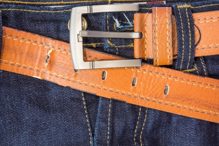 leather belt: Blue jeans and brown leather belt