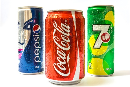 Pepsi ,Coca-Cola and 7 UP can isolated on white background