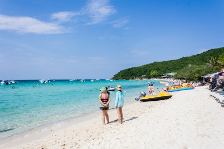 Tourist on the beach looking to the sea and blue sky at Koh Larn,Pattaya, Thailand photo
