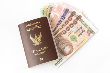 Thailand Passport and money isolated on white blackground photo