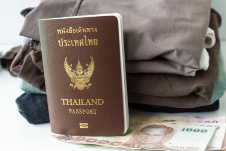 Thailand Passport andmoney on clothes heap photo