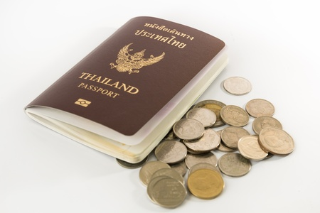 Thailand Passport and Thai money isolated on white background photo