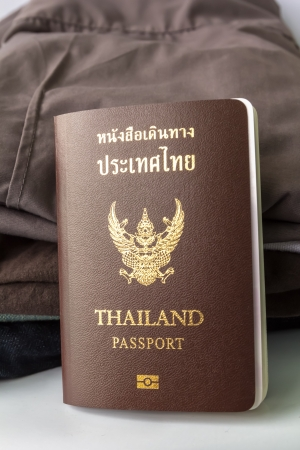 Thailand Passport and clothes heap photo