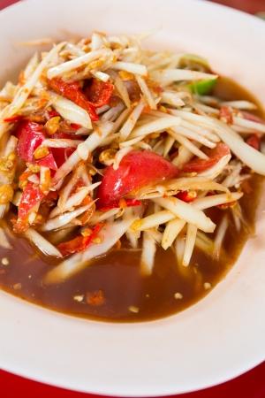 green papaya salad: Papaya salad, the famous food of thai Stock Photo
