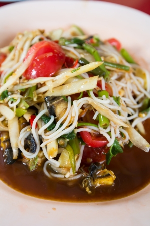 Papaya salad, the famous food of thai photo