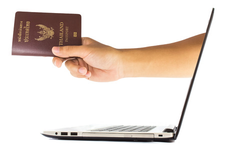 Thailand passport from laptop isolated on white background photo
