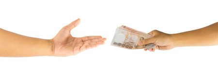 payee: Thai money in hand and open man hand isolated on white background