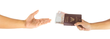 payee: Thai money and passport in man hand isolated on white background