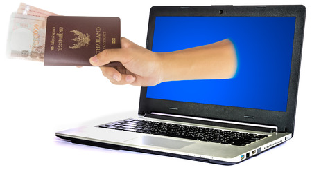 payee: Thailand passport and money from laptop isolated on white background Stock Photo