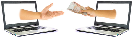 payee: Thai Money in hand from laptop isolated on white background