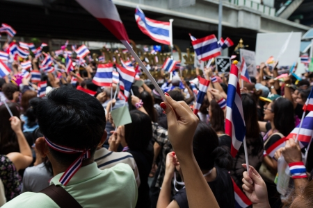 BANGKOK,THAILAND - NOVEMBER 7, 2013 : The Unidentified Thai people,Office worker, university students, and few foreigner protest against the disputed amnesty act in Asoke junction and the BTS Elevated train station, Bangkok