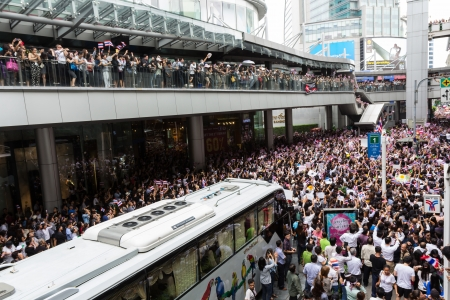 rightwing: BANGKOK,THAILAND - NOVEMBER 7, 2013 : The Unidentified Thai people,Office worker, university students, and few foreigner protest against the disputed amnesty act in Asoke junction and the BTS Elevated train station, Bangkok Editorial