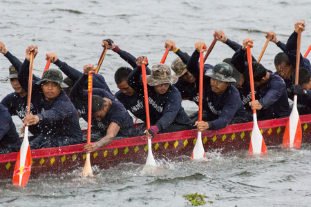 paddler: CHONBURI,THAILAND - NOVEMBER 18: Unidentified crew in traditional Thai long boats compete during Queen Cup Traditional Long Boat Race Championship on November 18,2012 in Pattaya,Chonburi Editorial