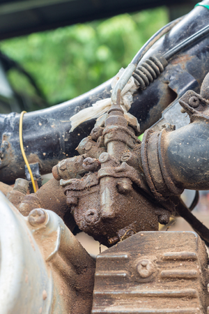carburetor: Old Shabby carburator sticked by olid slick  in old motorcycle