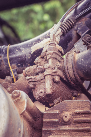 Old Shabby carburator sticked by olid slick  in old motorcycle in vintage style Stock Photo
