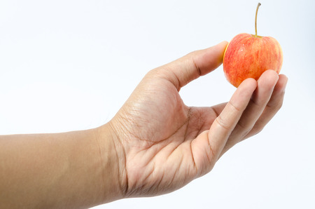 waterdrop: Isolated of fresh apple with waterdrop in human hand on white background