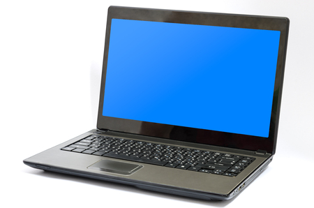 ultra modern: Black aluminium body laptop computer with blank blue screen isolated on white background