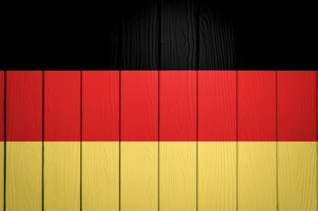 Germany flag painted on wooden texture background