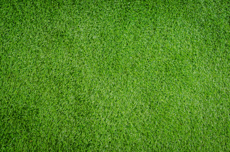 Closed-up of artificial green grass texture background Stock Photo