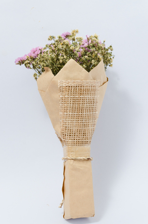 Bouquet of beautiful dry flowers wrapped in brown paper isolated bouquet of beautiful dry flowers wrapped in brown paper isolated on white background stock photo mightylinksfo