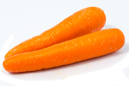 Group of two carrots isolated on white background