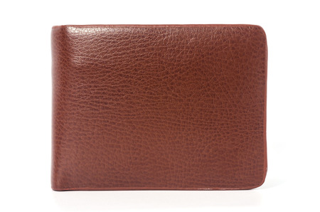 paying: Brown leather wallet isolated on white background