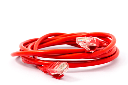 Red LAN Network cable with RJ-45 ports isolated on white background Stock Photo