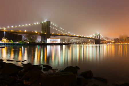 Foy Brooklyn bridge and downtown Manhattan at night. Stok Fotoğraf